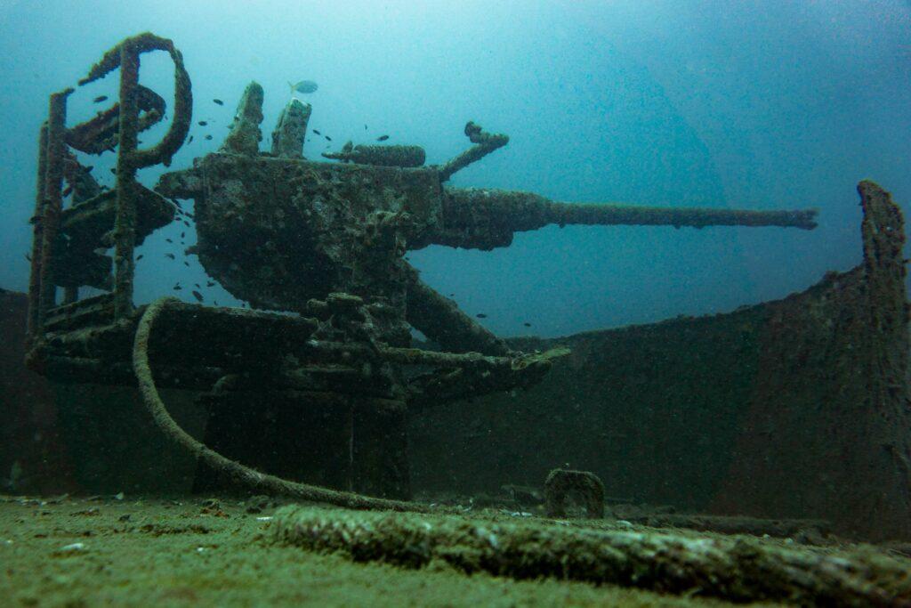 Naval artillery gun on a sunken warship