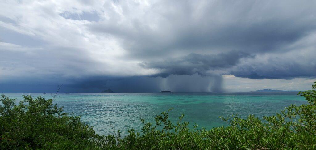 Rainstorm over the ocean near Laemtong Beach - Koh Phi Phi, Thailand