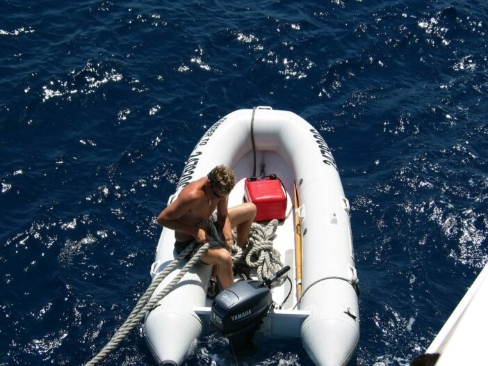 inflatable dinghy anchoring sea