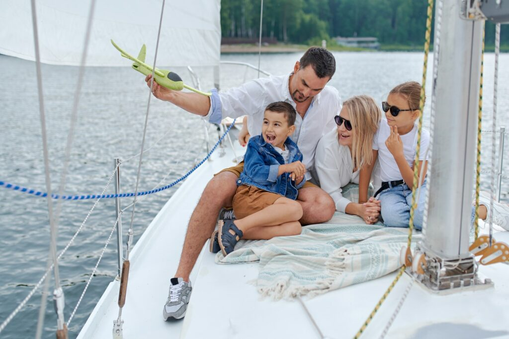 A family enjoying their time on the bow of the boat